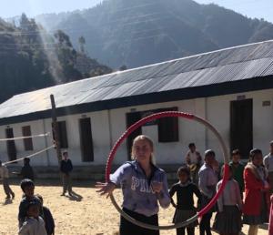 Hetty demonstrating how to use a hoola hoop